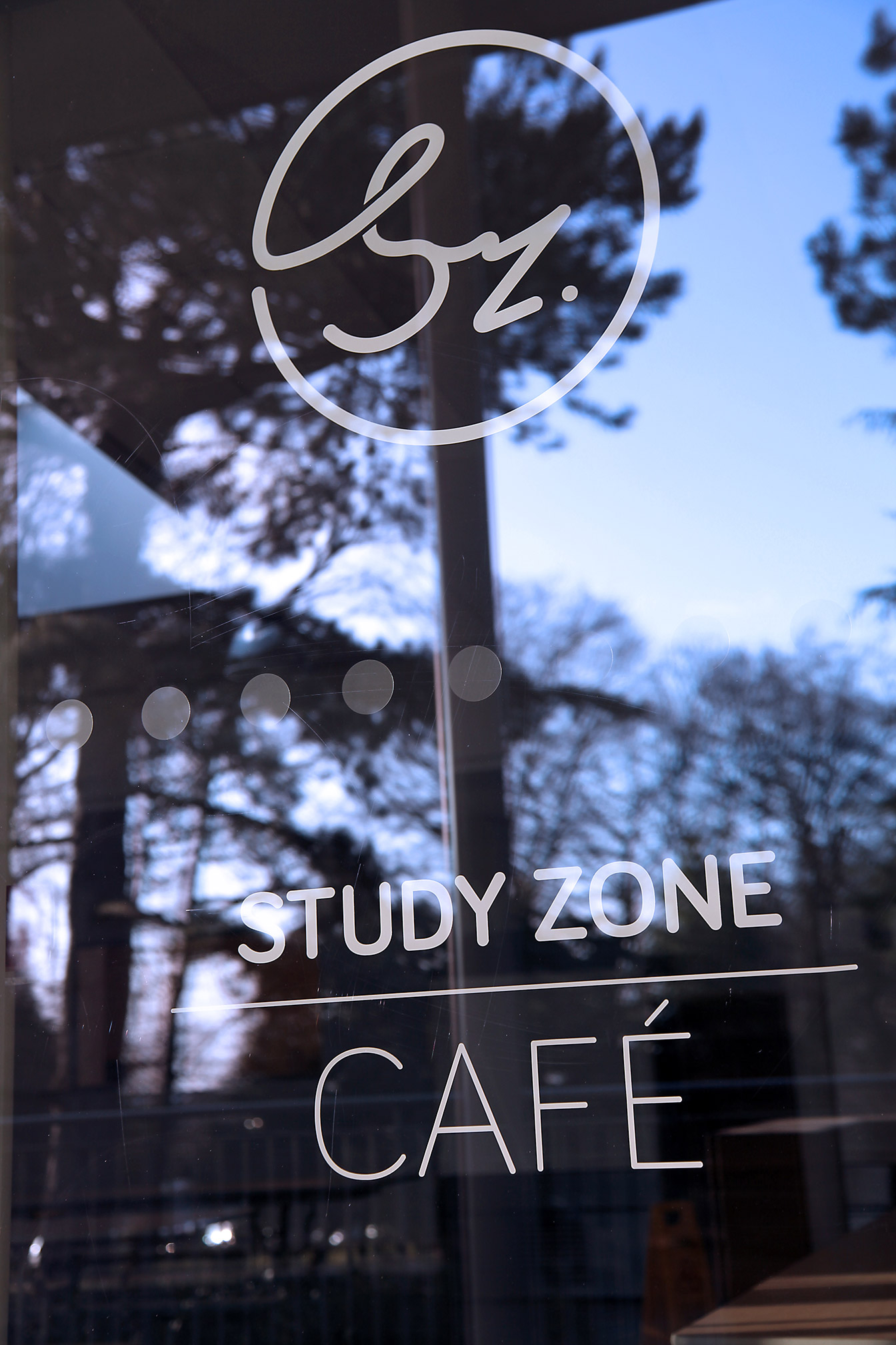 The Study Zone Cafe is branded with large vinyl window decals.