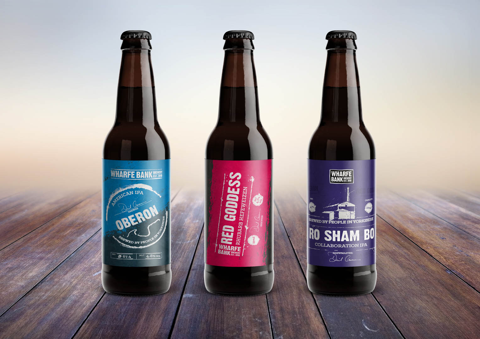 Three 330ml craft beer bottle concepts, incorporating old print design elements.